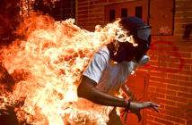 Candidates. A protester in flames during clashes with police during a protest against Venezuelan President Nicolás Maduro in Caracas, Venezuela. Image Credit: Romaldo Schemidt of Agence France Presse / AFP Agence France Press, 2018. A protester in flames during clashes with police during a protest against Venezuelan President Nicolás Maduro in Caracas, Venezuela. Image Credit: Romaldo Schemidt of Agence France Presse / AFP Agence France Press, 2018.