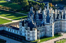 Château Chambord and how the restored roof would look, inset. Critics say the plan is a waste of money / ALAMY