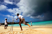 A celebrated cricketing legend in Antigua. Cricket at its simplest form - on a Caribbean beach Image Credit: Getty Images, 2019.