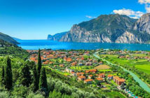 Visit the Italian lakes by train from London. Torbole and Lake Garda, Italy. Image Credit: Grtty Images, 2019.