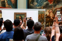 Want to see The Mona Lisa? Get in Line. Crowds in front of the Mona Lisa in the Medici Gallery on Monday.. Image Credit: Owen Franken for The New York Times, 2019.