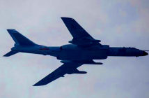 China's secret super missile, was revealed by a publishing error. An H-6 bomber seen over Beijing in September. Image Credit:: Ng Han Guan / AP Associated Press, 2019.