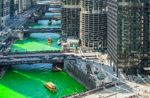 Enjoying a kayak adventure in Chicago, Illinois.Paddle straight into the heart of the Windy. Every St. Patrick's day, the Chicago River is dyed green in celebration City. Image Credit: Natasha J. Photography, 2020.