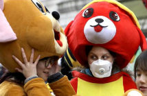 Coronavirus may already be in Europe. Some performers taking part in Chinese New Year celebrations in Soho wore protective masks. Image Credit: Kristy Wigglesworth / AP Associated Press, 2020.
