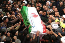 Iran warns, they will kill UK troops. Mourners carry the casket of Qasem Soleimani through the capital. Tensions between Iran and the US continue to escalate in the wake of the drone strike which killed him. Image Credit: Getty Images, 2020.