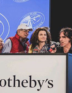 The Amelia Island Concours and Auction. - John Oates -- with microphone -- announces the sale of his 1984 Tiga race car at Amelia Island 2020 auction. Image Credit: RM Sotheby's, 2020.