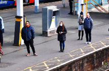 It's just like the war, says budget watchdog. Commuters keep their distance during rush hour at Clapham Junction in southwest London. Image Credit: Dylan Martinez / Reuters, 2020.