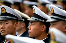 China's aggression amid the pandemichas little to do with COVID-19. Chinese sailors at a concert featuring Chinese and foreign military bands in Qingdao, China, April 22, 2019 . Image Credit: Mark Schiefelbein) / AP, 2020.