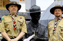 Scouts mobilize to defend Baden-Powell statue.. Rover Scouts Chris Arthur and Matthew Trott were among those who joined local residents around the statue of Lord Baden-Powell to try to stop the council removing it from Poole Harbour. Image Credit: Andrew Mathews /PA Press Associated, 2020.