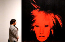 "Digital museum tours to tide you over. At The Tate Modern, a gallery assistant posed with Andy Warhol's ""Self Portrait, 1986"" in early March. Image Credit:Justin Tallis / AFP Agence France Presse via Getty Images, 2020."
