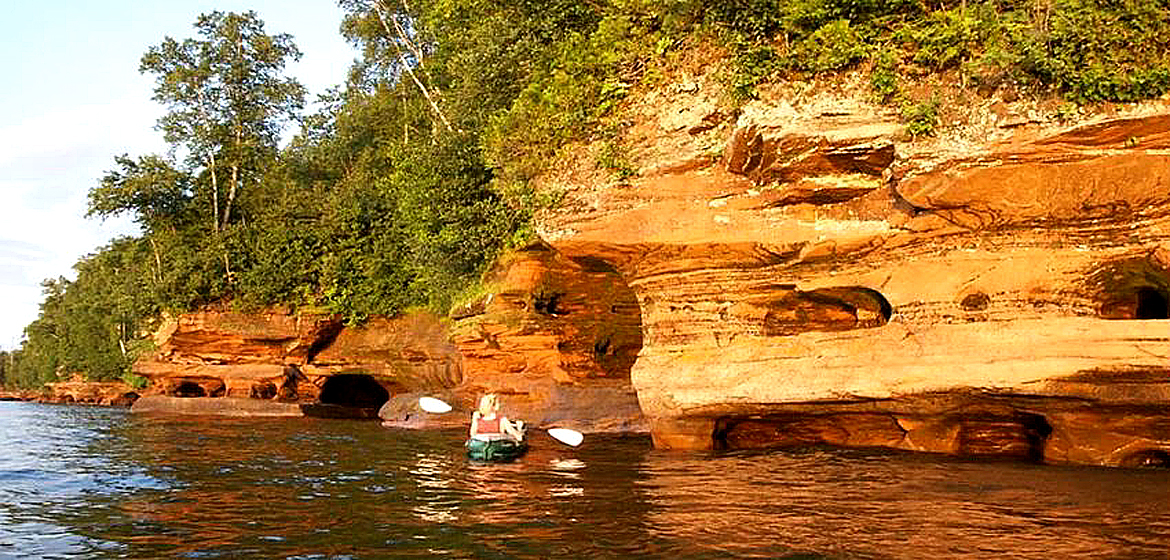 Explore sea caves and wild islands, kayaking The Apostle Islands. Whether day trip or overnight excursion, the Apostle Islands have plenty to offer kayakers. | Photo by: Flickr // Tim Wilson