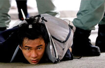 Dominic Raab says Hong Kong security law 'violates Joint Declaration'. A man detained by riot police during a march against the national security law in Hong Kong today. Image Credit: REUTERS, 2020.