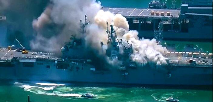 Firefighters battle massive blaze on US navy ship.