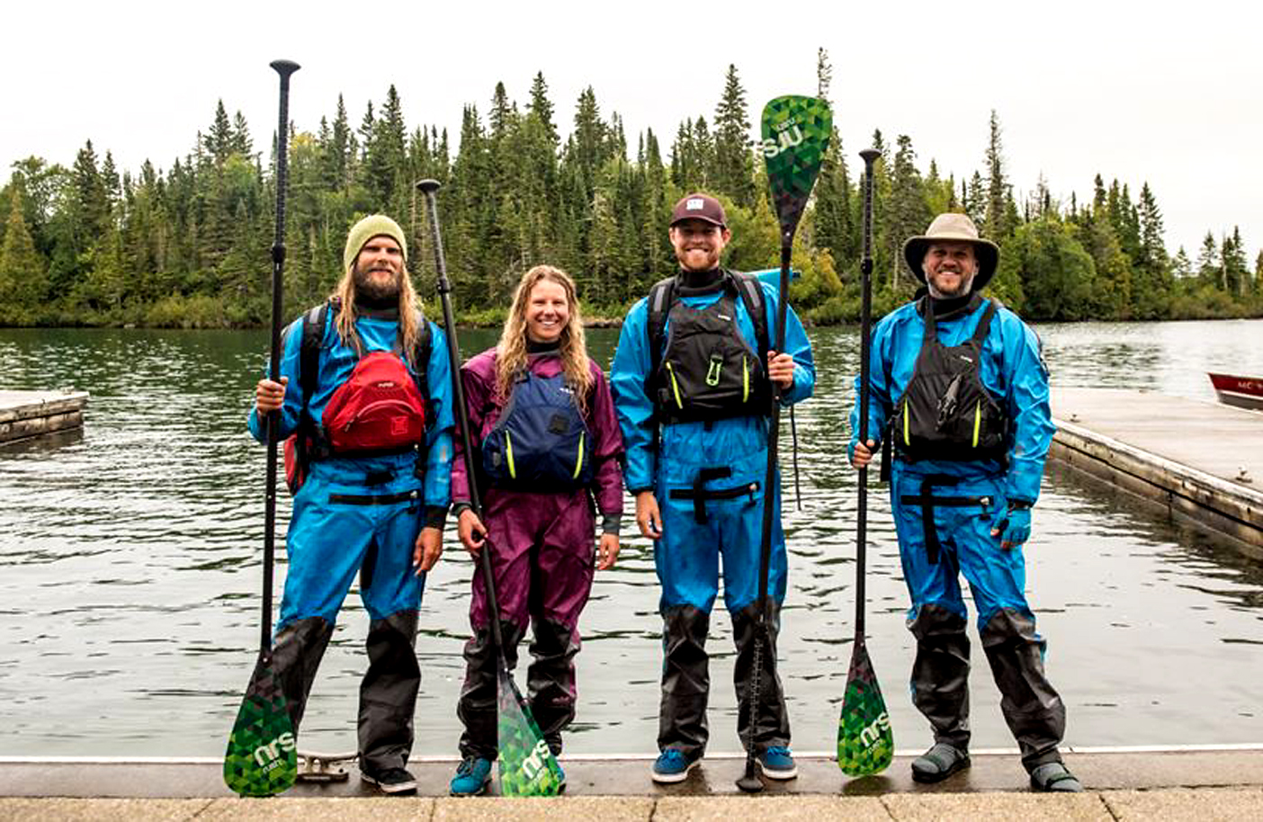 How to spend one wondrous week. Andrew Koch, Olivia Harrell, Aaron Black-Schmidt and Jack Haworth assemble for a post-trip photo after seven days of paddling Isle Royale. Image Credit:| Aaron Black-Schmidt