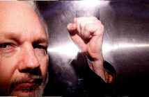 Julian Assange cannot be extradited to US, court rules.. Julian Assange in a prison van after a court appearance in May 2019. Image Credit: Neil Hall / EPA, 2019.