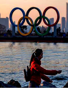 Tokyo Olympics will go ahead. The pandemic is expected to add $3 billion to the $25 billion cost of hosting the Olympic and Paralympic Games. Image Credit: Philip Fong / AFP Agence France Presse / Getty Images, 2020.