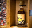 Macallan's anecdotes of Ages Collection. Estimated $125,000–750,000, the extraordinary , multi-component lot, includes a print donated by Sir Peter as well as a bespoke VIP experience with the Macallan, will lead Sotheby's, first dedicated spirits sale in New York, on March 13th. Image Credit: Sotheby's, 2021.