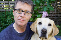 Nicky Campbell and his dog, Maxwell. He was saved after a breakdown by his dog. The TV presenter tells Andrew Billen how his labrador pulled him back from the brink of despair when mental illness felled him.. Image Credit: The Times, London, UK, 2021.