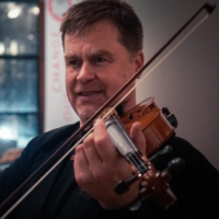 Teacher Peter Sulski playing violin
