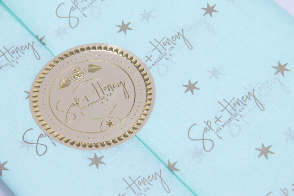 Custom printed branded tissue paper and embossed labels