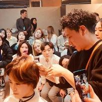 Shinichi Takahashi, current President of Hikari Japan, champion hairdresser, and master scissor craftsmen, demonstrating cutting techniques in Taiwan 2019.