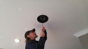 SpeakerCraft Profile in-ceiling speakers being installed