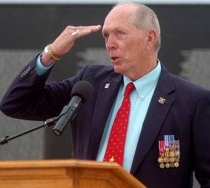 Bill Schwertfeger, Lt. Col, USAF, Retired, POW Hanoi Hilton 71-72, salutes all service men who lost their lives defending the United States during his keynote address at the Vietnam Memorial Wall Name Placement Ceremony at Enid Woodring Regional Airport Friday, May 16, 2014. (Staff Photo by BONNIE VCULEK)