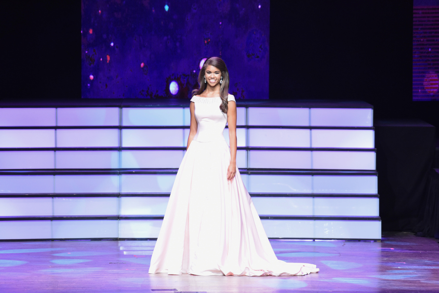 Kayley walking on stage in evening gown