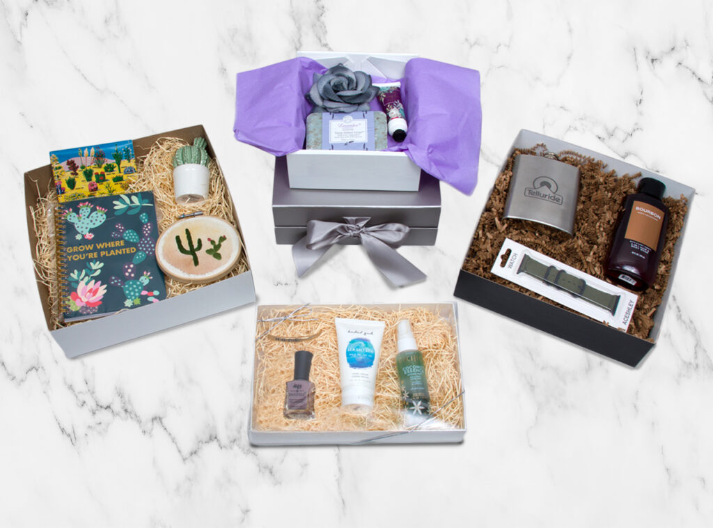 Variety of gift boxes with curated gift items inside