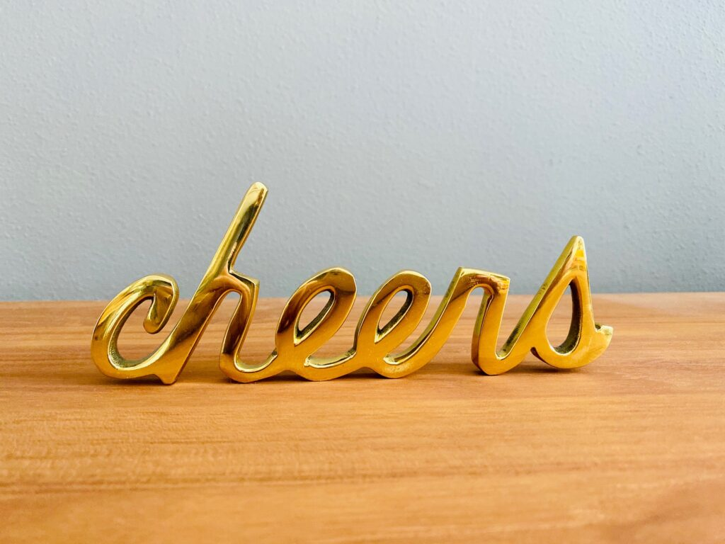Gold Cheers Sign