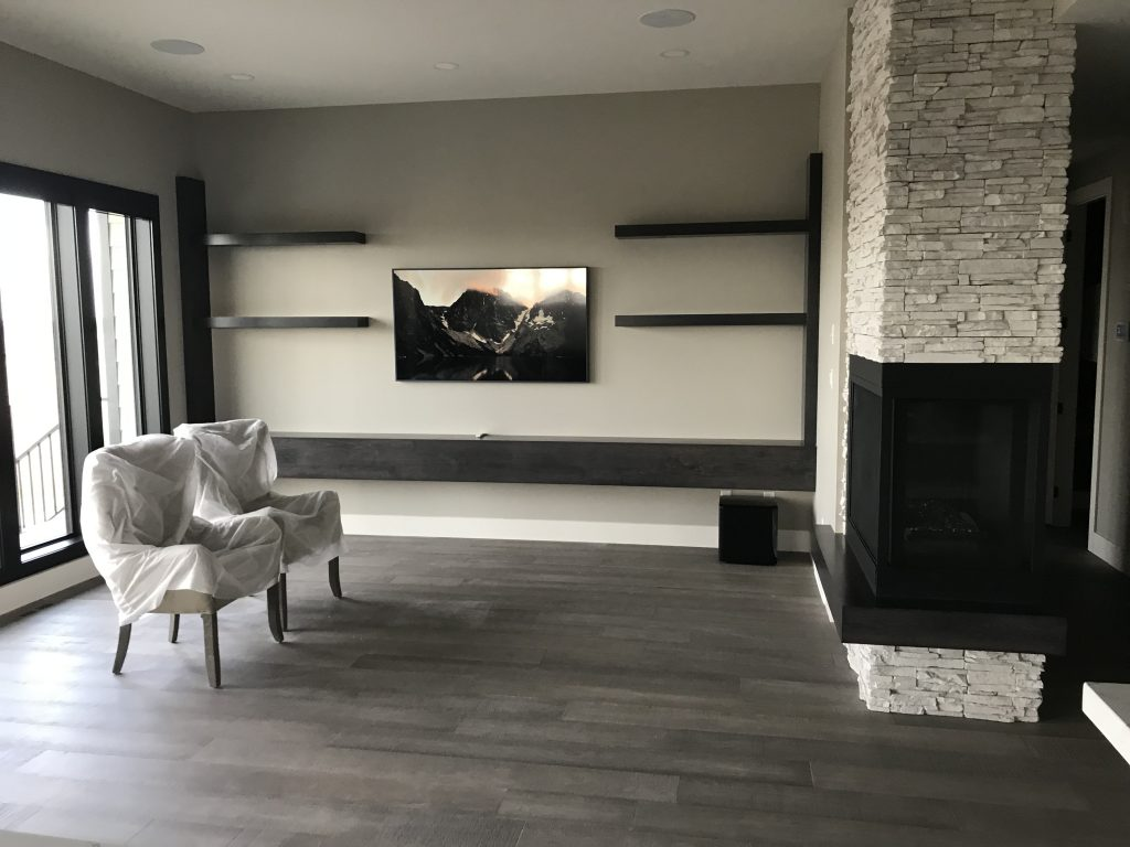 mounted television next to large windows