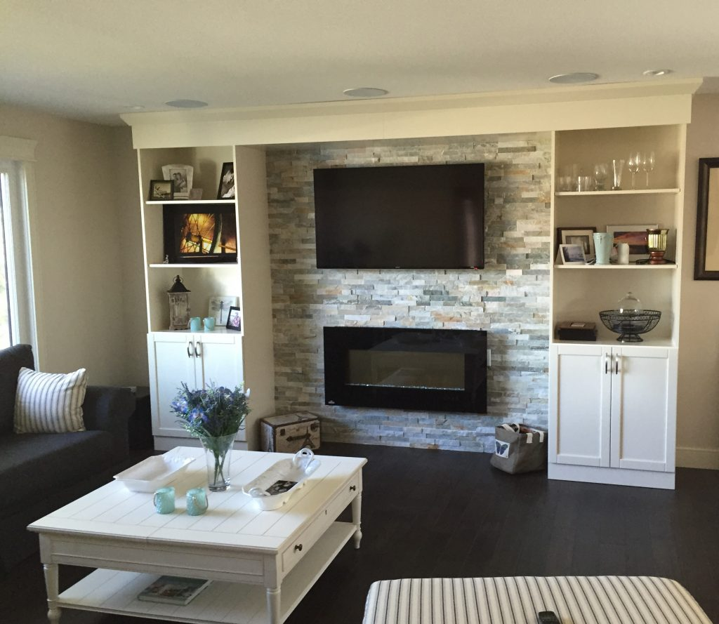 Television mounted above a fireplace in the living room