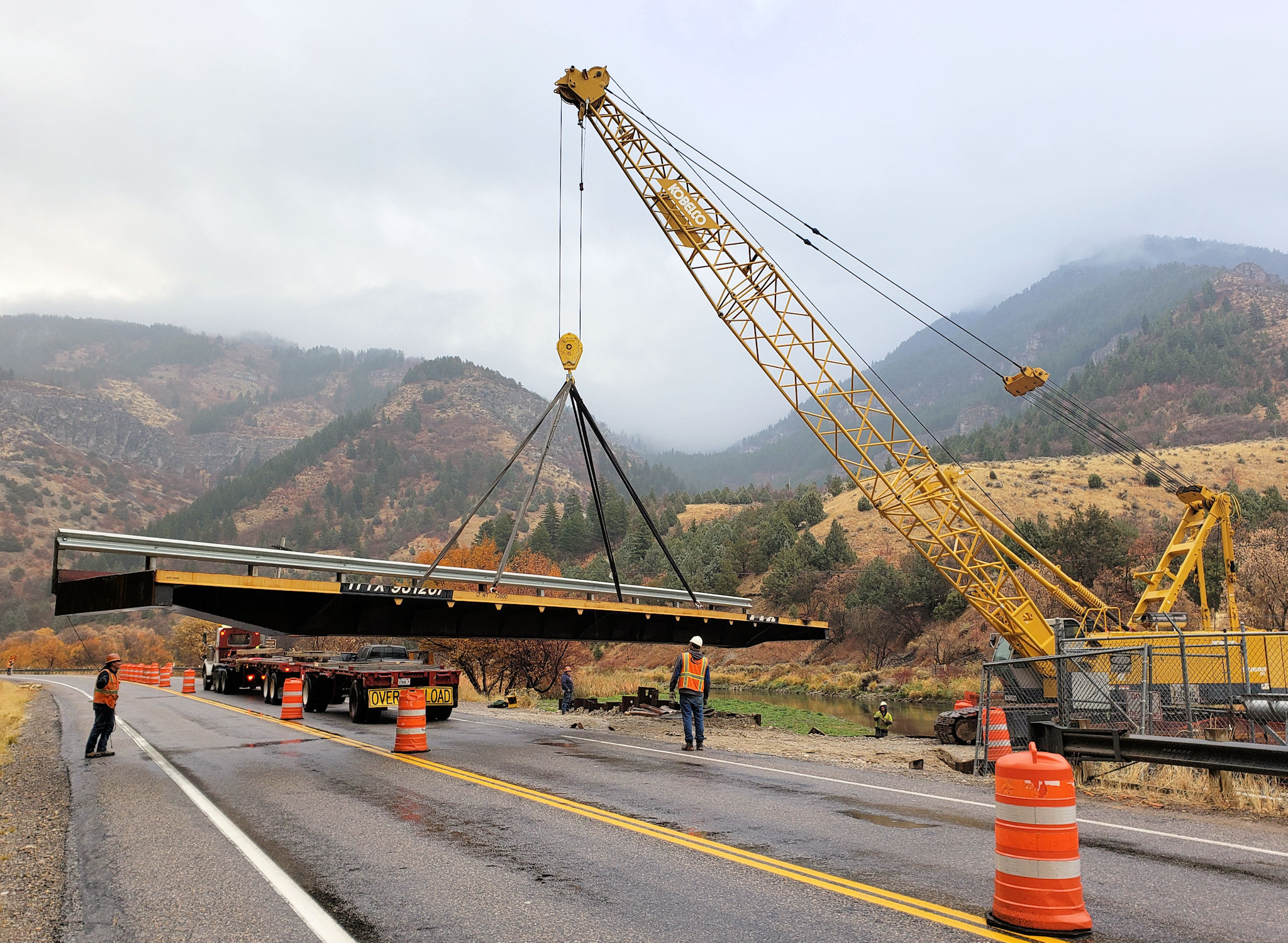 Swinging one half of the bridge into place.
