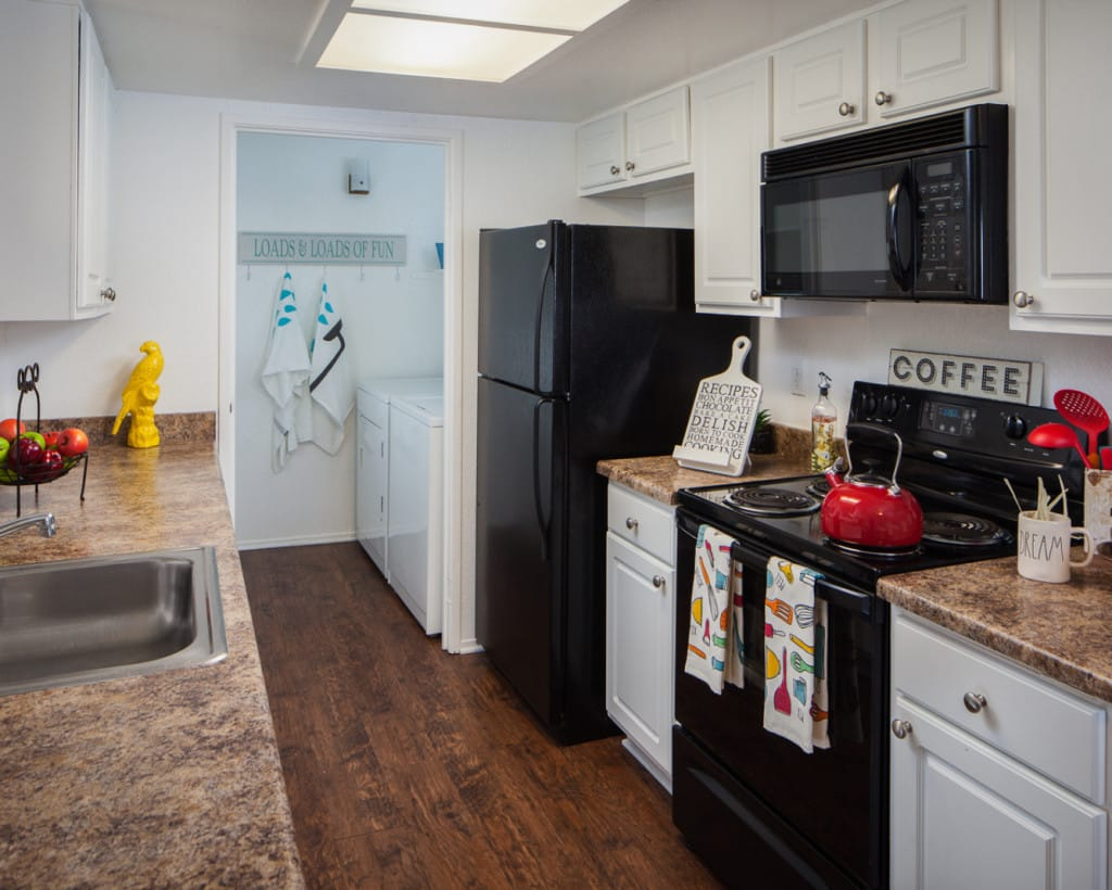 Interior of Kitchen with appliances and white cabinetry