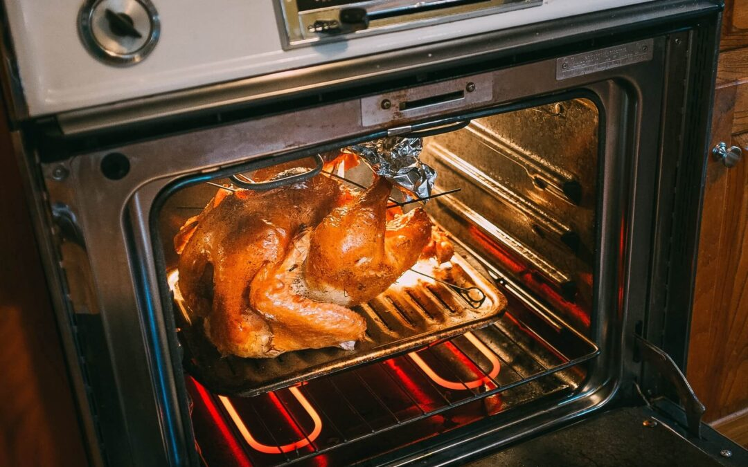 a whole turkey being roasted in the oven