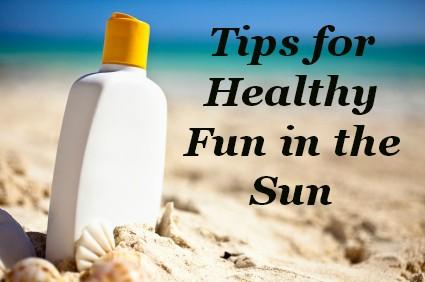 Bottle of suncreen on a sunny beach beside the ocean.