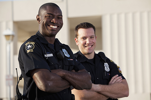 Two Smiling Police Officers