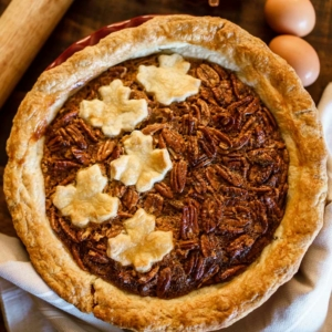 Photo of pecan pie decorated with fall leaves