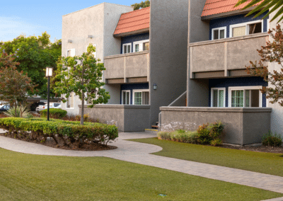 apartment homes patio and balcony with view of garden pathway