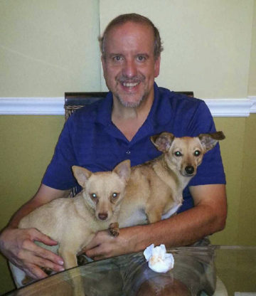 Client Mario Accumanno frontal picture after weight loss holding his dogs