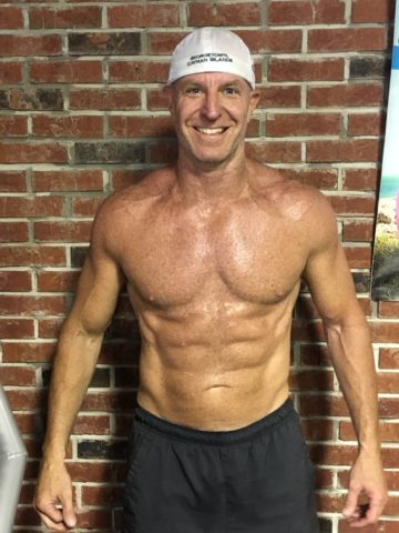 Client Ryan Dick six pack abs smiling frontal after picture