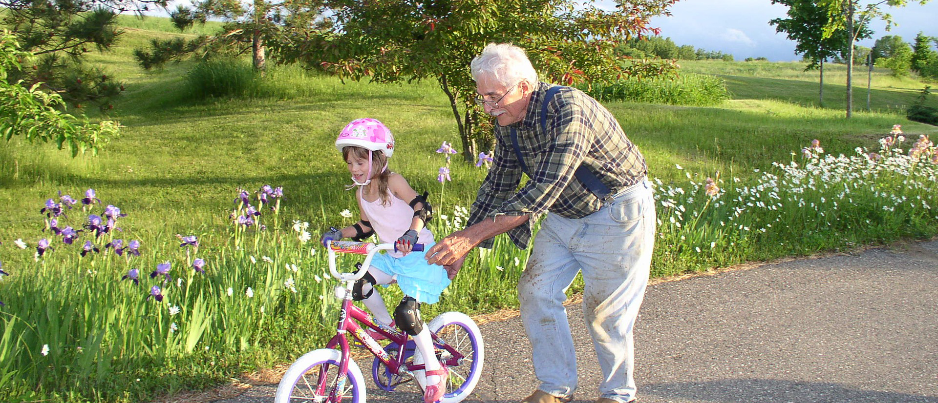 Grandfather with granddaughter riding bicycle Video Biographies