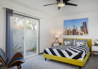 bedroom area in uptown fullerton apartment with furniture and decor