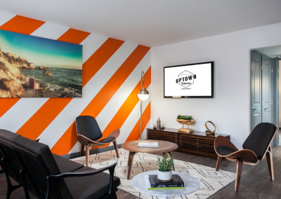 leasing office with orange wallpaper and furniture