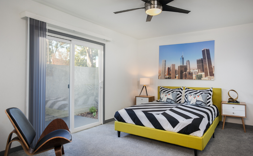 Furnished Bedroom in Uptown Fullerton Apartment with decor and windows