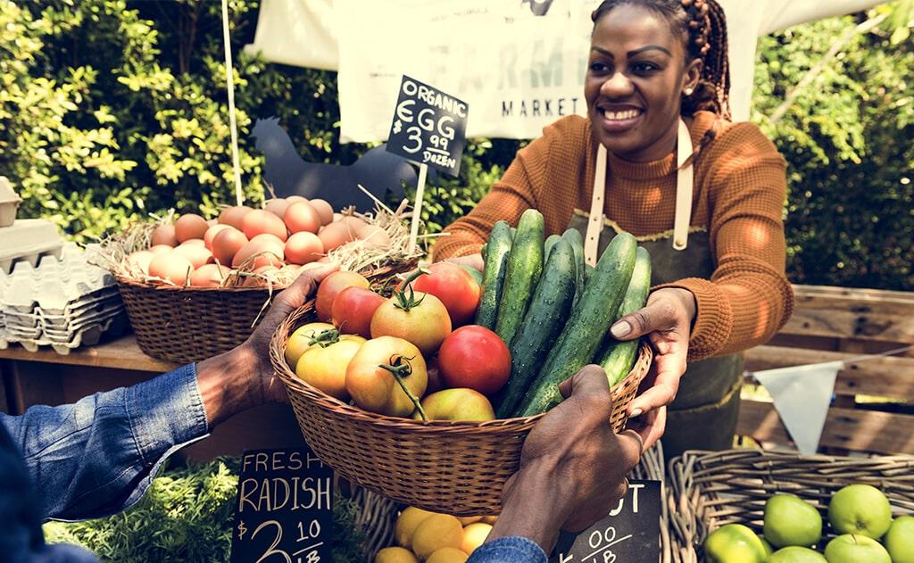 women selling vegetables