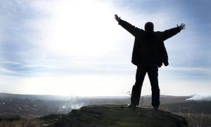 confident guy on mountian