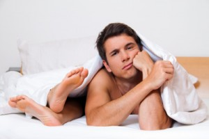 A young couple in bed has problems and crisis. Divorce and separation.