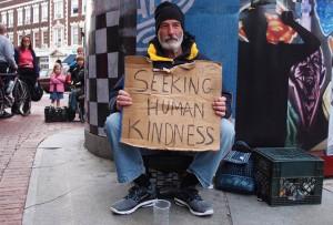 man with sign seeking human kindness