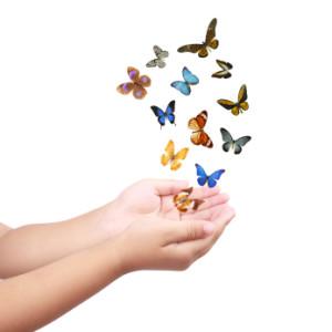 small hand releasing butterflies